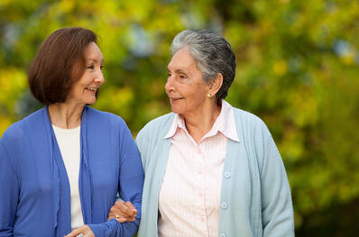 Portrait of an elder mother and daughter walking outdoors