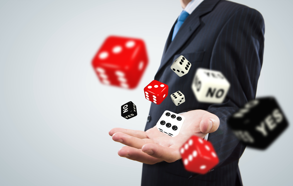 Close up of businessman throwing dice. Gambling concept-1