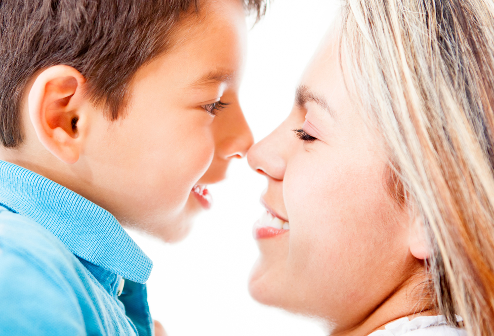 Portrait of a mother and son - isolated over a white background