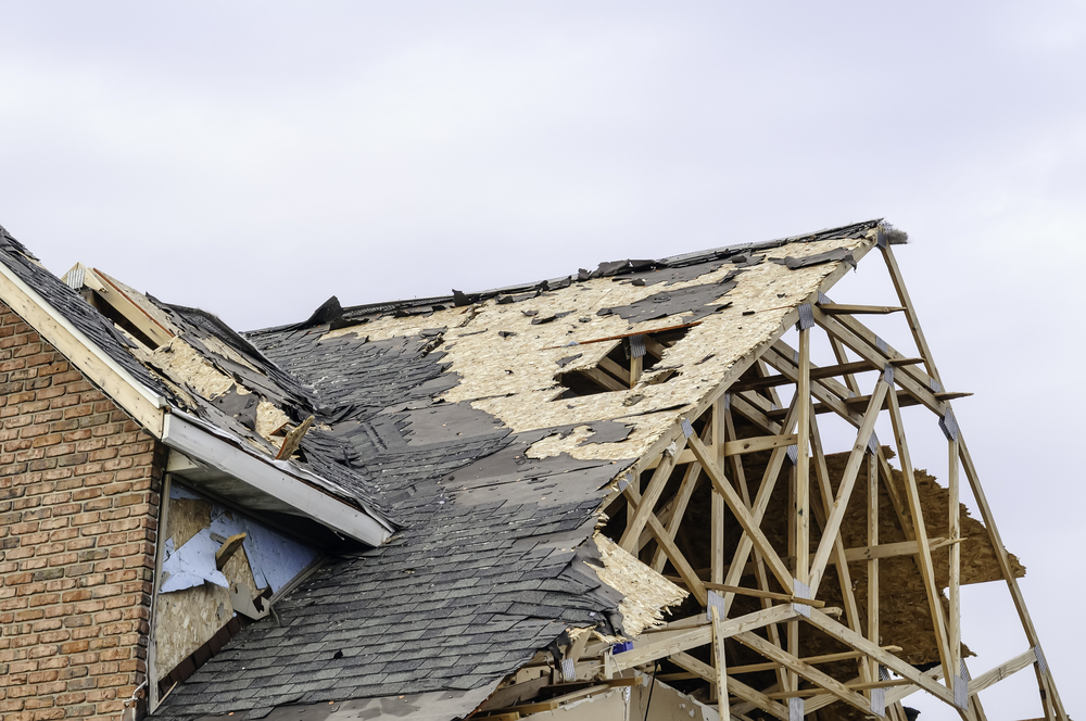 Skeletal remains of peaked roof on house hit by tornado